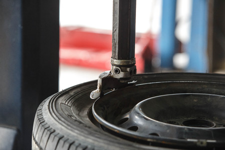 Remove tyre with tyre changer machine Stock Photo