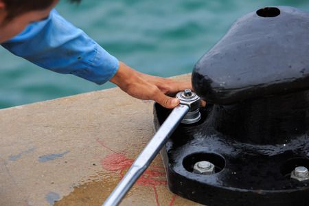impact wrench: Torque achor bolt of bollard with torque wrench Stock Photo