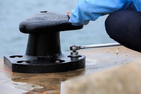 torque: Torque achor bolt of bollard with torque wrench Stock Photo