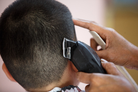 clipper: Haircut skinhead with hair clipper