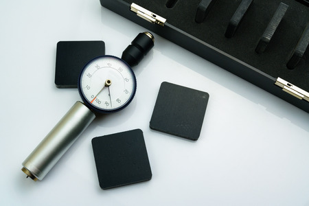 Calibration Rubber hardness testter with standard hardness test block Stock Photo