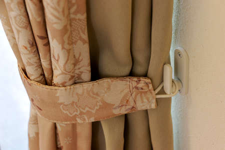 a curtain fastened to the wall hook
