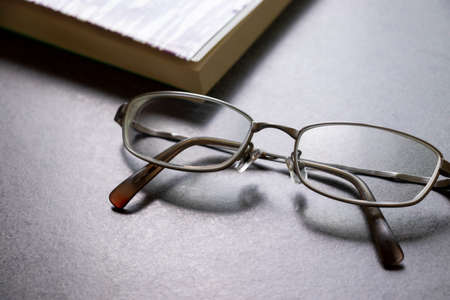 Glasses and books on the table