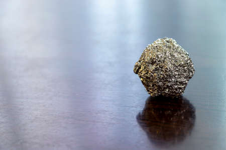 Silver ball made by rolling metal foil