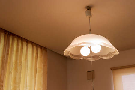 Lighting fixtures suspended from the ceiling