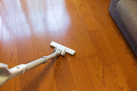 Vacuum the wooden flooring