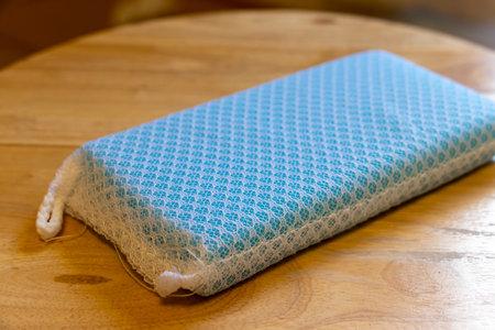 Blue sponge wrapped in a net 版權商用圖片