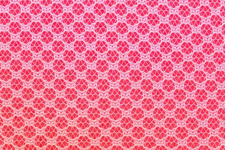 Pink sponge wrapped in a net