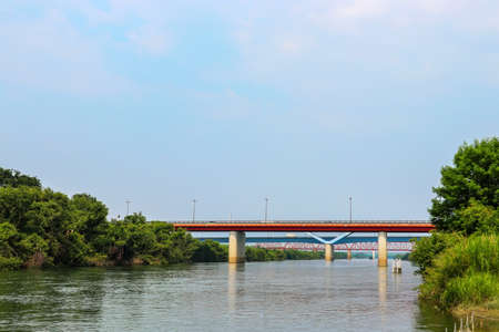 Yodo River with red bridge in Yawata City, Kyoto Prefecture Banque d'images