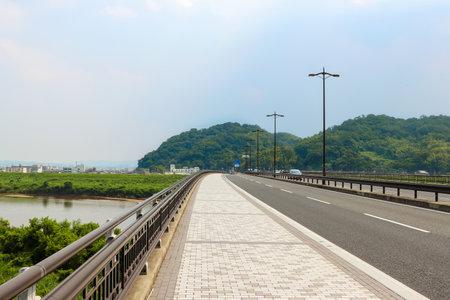 View of Otokoyama from on the bridge over Kizu River in Yawata, Kyoto
