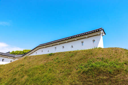 White wall with holes on earthwork in Japanese Castle