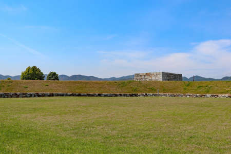 Stone wall left in the field at Japanese castle ruins