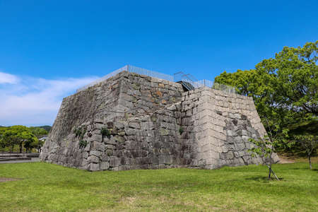 Large stone foundation for castle tower left in Japanese castle ruins