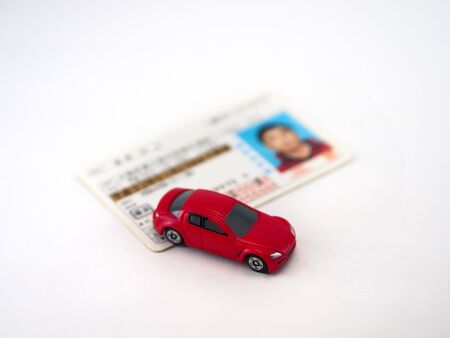 Minicar toy and Japanese driver's license