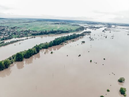Flood on the Dniester River. Flooded village of Galich. Fields in dirty water. Natural disasters, rains and floods.