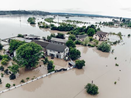 Flooded village on Ukraine. Natural disaster in Halych, courtyards and streets in dirty water. Global catastrophe, climate change, flood concept. Banque d'images