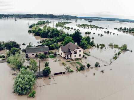 Flooded yard near the Dniester River. Flood on the river. Natural disaster in Western Ukraine.
