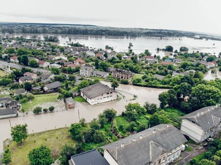 Aerial view of the flooded city of Halych, Western Ukraine. Flood on the Dniester River, flooded streets and houses in Halych. Global catastrophe, climate change, flood concept.