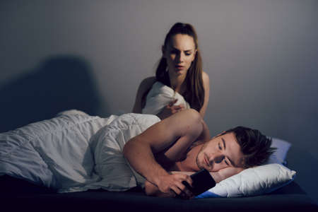 The husband corresponds with his mistress while his wife sleeps. Betrayal, problems in a young family