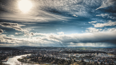 beautiful city view with blue sky, sun and rain clouds. Koblenz in Germany Stock Photo