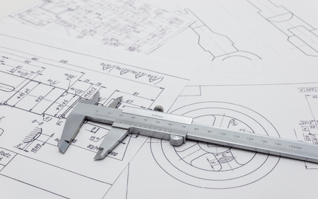 Vernier caliper lying on mechanical scheme. Stockfoto