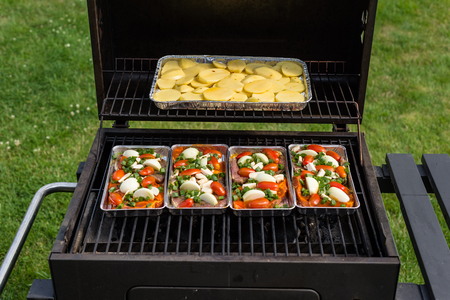 Opened grill with food on the inside of the garden.