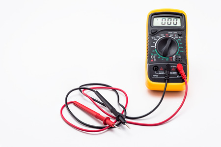Electric multimeter with red and black probe, display showing zero, with printed circuit board. Isolated on a white background with a clipping path. Stok Fotoğraf
