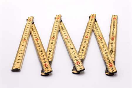 Wooden folding ruler isolated on a white background.