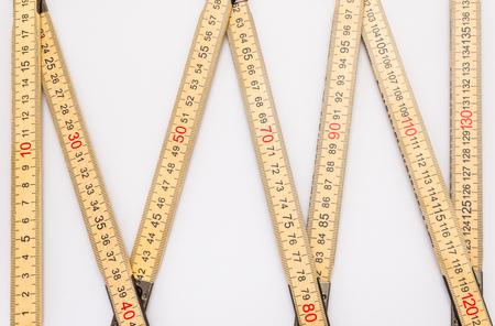 Wooden folding ruler isolated on a white background. Standard-Bild