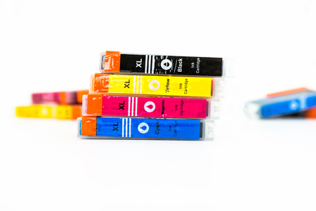Close-up shot of a CMYK ink cartridges for a color printer isolated on a white background. Stock fotó