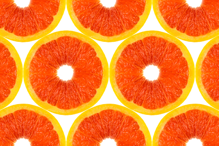 Pattern made from fresh grapefruit on white background, overhead view, flatlay. Fruit background.