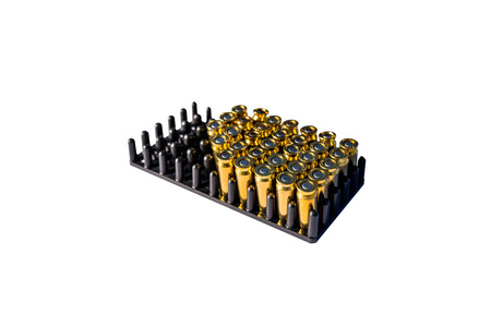 A lot of blind cartridges for guns in the package with 8mm caliber, isolated on a white background.