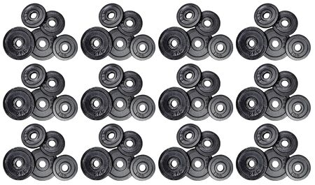 Pattern made from a stack of metal weights 1kg and 2kg, isolated on white background with clipping path. Top view, flat lay. Can be used as a gym background.
