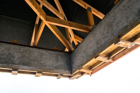 Roof trusses covered with a membrane on a detached house under construction, visible roof elements, battens, counter battens, rafters.
