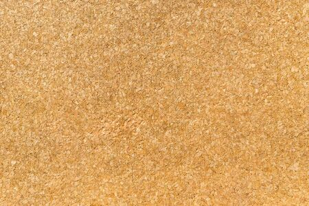 Texture from a corkwood background in brown-yellow color, close up shot.