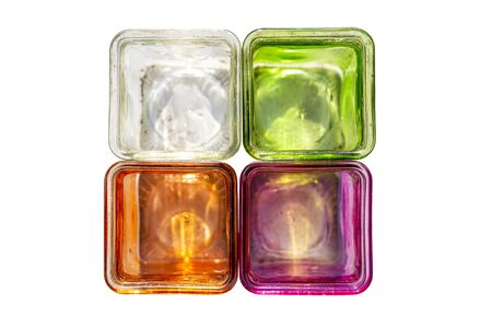 Colored glass coasters for tealights, flat lay, isolated on a white background with a clipping path.