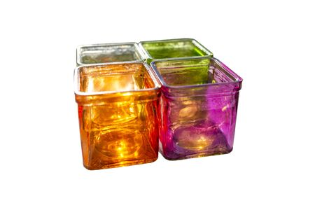 Colored glass coasters for tealights, side view, isolated on a white background with a clipping path. Standard-Bild