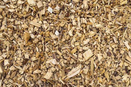 Background made of wood chips, closeup shot, wooden texture. Standard-Bild