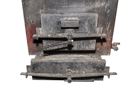 Old metal coal and wood stove with the door closed, isolated on a white background with a clipping path.