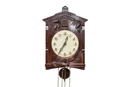 Large wall clock made of wood, isolated on a white background with a clipping path.
