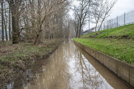 The high state of the river Rhine in western Germany, which emerged from the riverbed, flooded pavement and bicycle path.