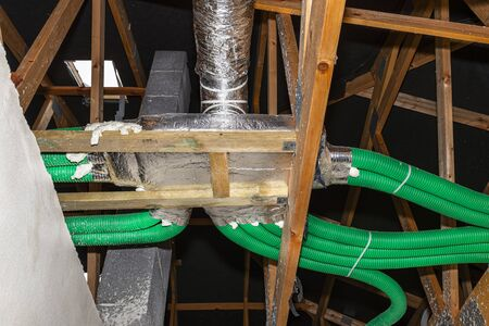 Home energy recovery ventilation, visible manifold and green flexible pipe connection.