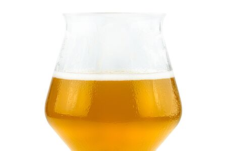 Cold beer in a Teku tasting glass half filled, drops of water on glass and foam, isolated on a white background with a clipping path.