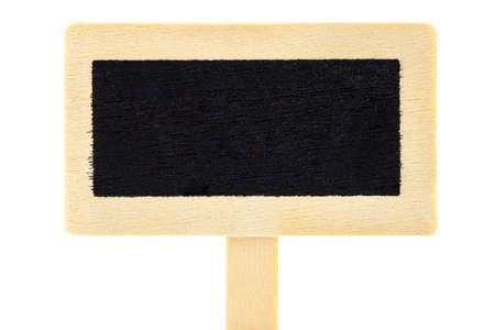 Macro shot of an empty wooden signs with a black center on a stick, isolated against a white background
