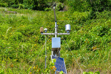 Mobile weather station with solar panel placed on a hill in wineries to monitor atmospheric conditions. 写真素材