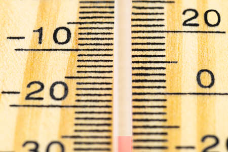 A macro shot of a classic wooden thermometer showing a temperature -25 degrees Celsius, -13 degrees Fahrenheit. 写真素材