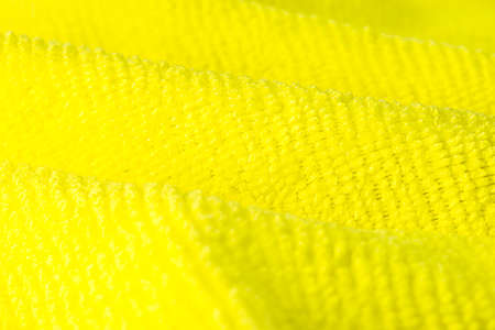Background made of yellow microfiber fabric, selective focus. Stock Photo