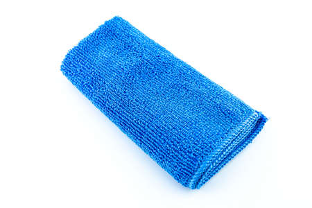 Blue microfiber fabric lying in the middle, isolated on a white background, top view. 写真素材
