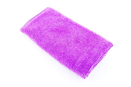 Purple microfiber fabric lying in the middle, isolated on a white background, top view.