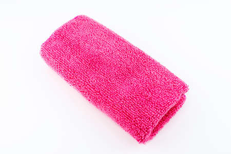 Pink microfiber fabric lying in the middle, isolated on a white background, top view.